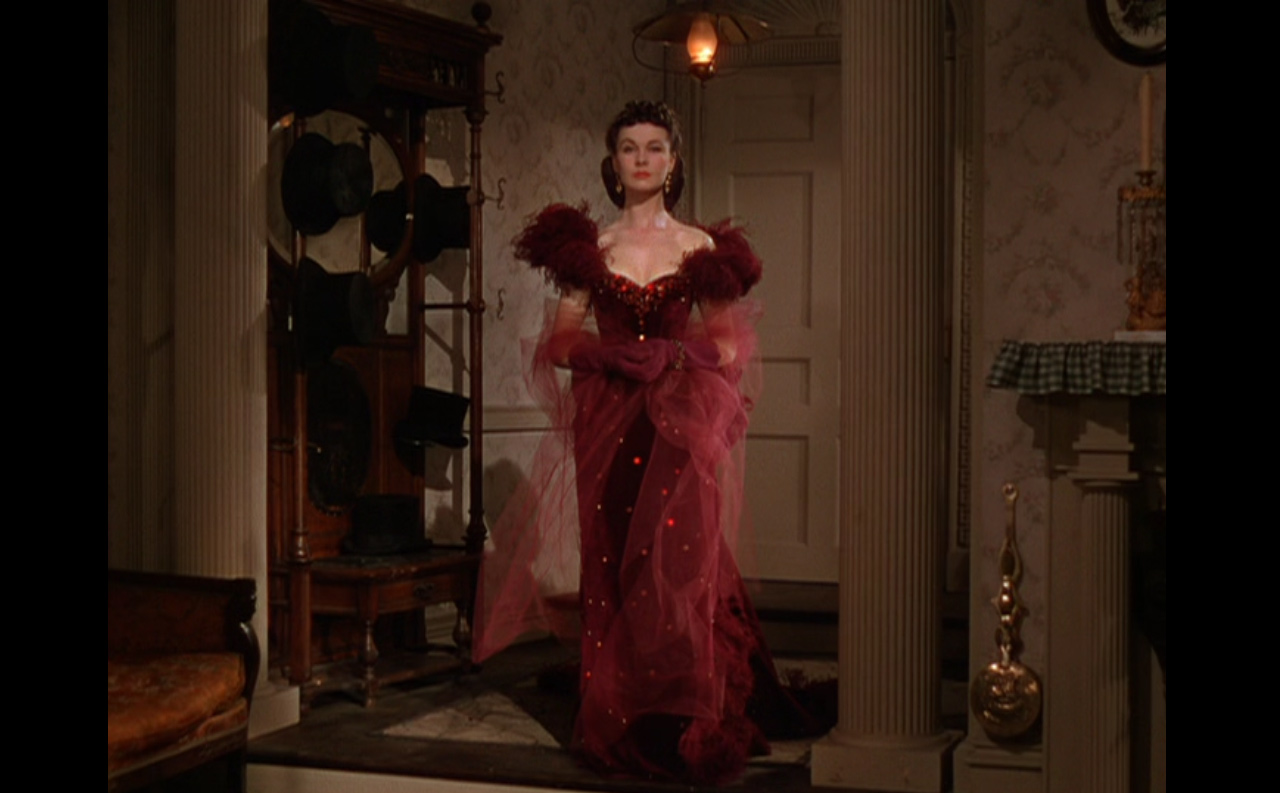 Lady in red thread by costumes on screen