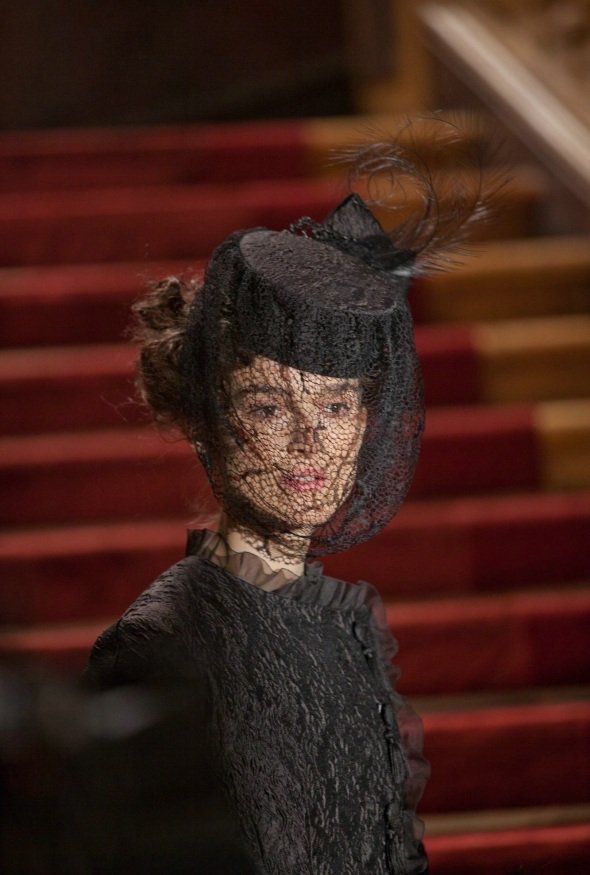 Upon fleeing home Anna dons an asymmetrical black crushed silk gown with a hat and veil that essentially hides Anna's face.