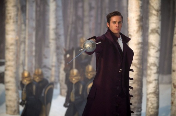 The choice of purple for his second chance meeting with Snow is appropriate, representing both his royal status and his loyalty to Snow White.