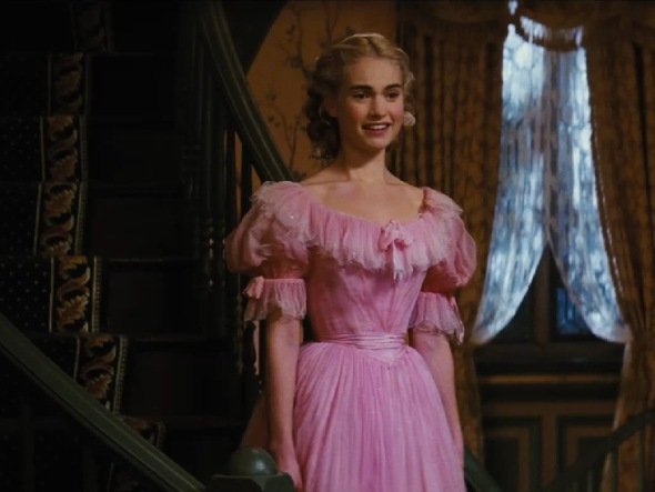 The pale pink dress is clearly and old one and does make Cinderella looks as though she is playing dress up, making the notion that she loves it and want to wear it to the ball, all the sweeter.