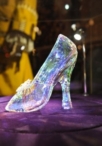 "The ""Glass"" Slipper designed for the film made by Swarovski, also included a golden butterfly studded with smaller crystals."